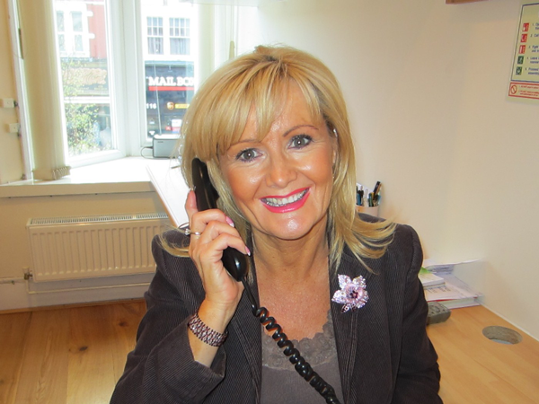Dental receptionist Lucy Phillips on the phone